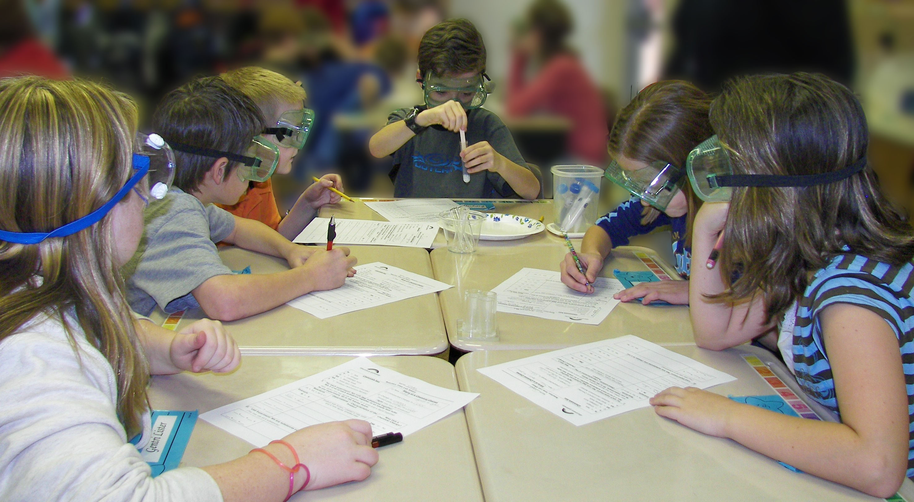 Kids experimenting with test tubes.